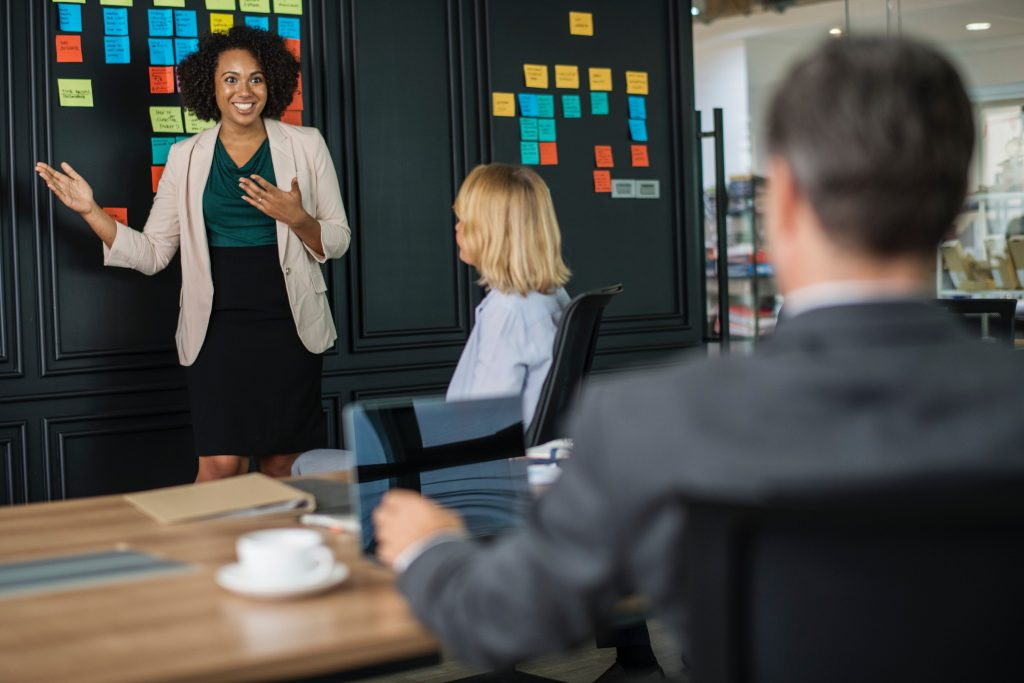 Woman Presenting to Executive